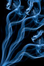 Blue smoke isolated over black Royalty Free Stock Images