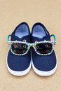 Blue sneakers and sunglasses. Summer holidays Royalty Free Stock Photo
