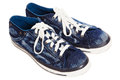 Blue sneakers on white background Royalty Free Stock Photo