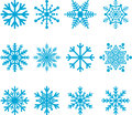 Blue snowflakes collection or set of on white in a variety of shapes and patterns Stock Photos