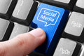 Blue social media button on the keyboard closeup of Royalty Free Stock Image