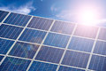 Blue solar cells, blue sky and sun Royalty Free Stock Photo