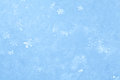 Blue sparkling snow background with white little snowflakes Royalty Free Stock Photography