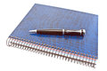 Blue spiral notebook with pen on white Stock Photo