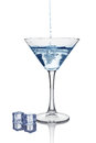 Blue splash in glass of white transparent alcoholic cocktail drink with ice cube Royalty Free Stock Photo