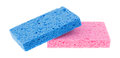 Blue sponge atop a pink sponge Royalty Free Stock Photo