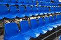 Blue stadium seats empty plastic at open door sports arena Stock Photo