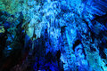 Blue stalactites in cave Royalty Free Stock Images