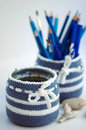 Blue stationery and white nesting bowls in crochet with pencils and Royalty Free Stock Image