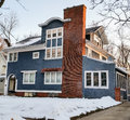 Blue stucco home with white trim historic on winter day Royalty Free Stock Image