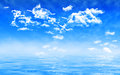 Blue summer sky with clouds over water with waves Royalty Free Stock Photo