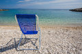 Blue Sunchair on the beach Royalty Free Stock Image