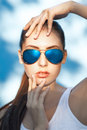 Blue sunglasses beautiful young girl in on background Stock Photography