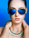 Blue sunglasses close up face of beautiful young girl in Royalty Free Stock Images
