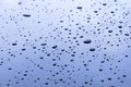 Blue surface with water drops Royalty Free Stock Photo