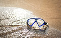 Blue swimming mask on sea beach Royalty Free Stock Image