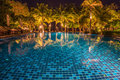 blue swimming pool with light reflections at night Royalty Free Stock Photo