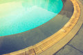 Blue swimming pool rippled water filtered image processed vi vintage effect Royalty Free Stock Photography