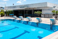 Blue swimming pool and starting places at hotel Royalty Free Stock Photo