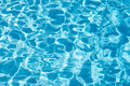 Blue swimming pool water texture background Royalty Free Stock Photo
