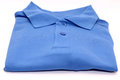 Blue t shirt over white background Royalty Free Stock Images