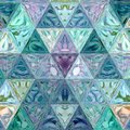 Blue and teal geometric abstract polygonal triangular pattern.