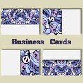 Blue template business cards with oriental pattern and geometric circle element.