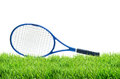 Blue tennis racket on green grass isolated white Royalty Free Stock Photo