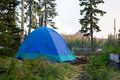 Blue Tent at Big Lake Campsite Royalty Free Stock Photo