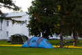 Blue tent on green lawn Royalty Free Stock Photo