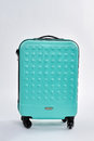 Blue textured suitcase for travel. Royalty Free Stock Photo