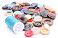 Blue thread with needle and collection of colored sewing buttons closeup various isolated on white Stock Photo