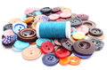 Blue thread with needle and collection of colored sewing buttons closeup various isolated on white Royalty Free Stock Images