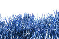 Blue tinsel garlands of over white as a background Stock Photography