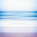 Blue toned seascape an abstract ocean with blurred panning motion image displays a and purple split color scheme Stock Photos