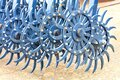 Blue toothed metal harrow for field tillage
