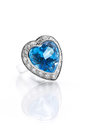 Blue topaz surrounded with diamond ring Royalty Free Stock Photo