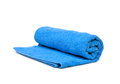 A blue towel rolled up Royalty Free Stock Images