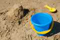 Blue toy bucket and yellow spade Royalty Free Stock Photo