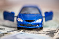 Blue toy car with dollar Royalty Free Stock Photo