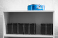 Blue toy case with black and white cases on the shelf background Royalty Free Stock Photo