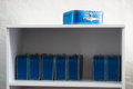 Blue toy cases on the shelf background Royalty Free Stock Photo