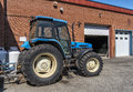 Blue tractor parked under a clean sky Stock Photography