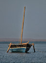 Blue traditional dhow in pemba bay a or tribal sailing boat is anchored the of northern mozambique Royalty Free Stock Photos