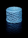 Blue twine coil a string in black reflective back Royalty Free Stock Images