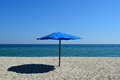 Blue umbrella  on a beach Royalty Free Stock Photo