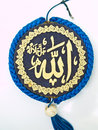 A blue velvet Allah pendent isolated on white Stock Image
