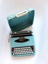 Blue vintage manual typewriter stylish on a white background Stock Image