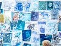 Blue vintage postmarks, stamp collecting. The hobby and philately concept. Royalty Free Stock Photo