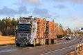 Blue Volvo FH16 Wood Transport Truck on Highway in Winter Royalty Free Stock Photo